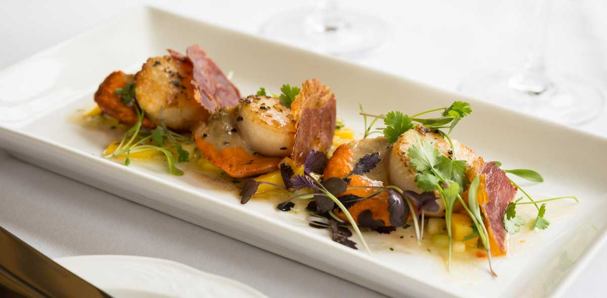 Scallops and bacon starter - Restaurant 1872 at Penmorvah Manor